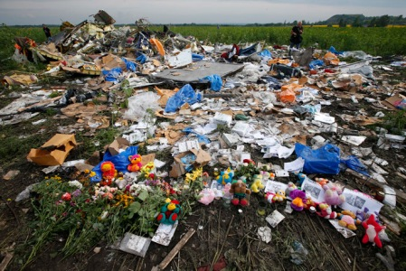 Flowers and mementos left by local residents at the crash site of Malaysia Airlines Flight MH17 are pictured near the settlement of Rozspyne in the Donetsk region
